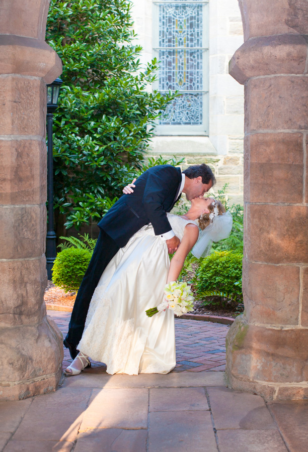 wedding couple kissing in churchyard , Willa Stein Photography
