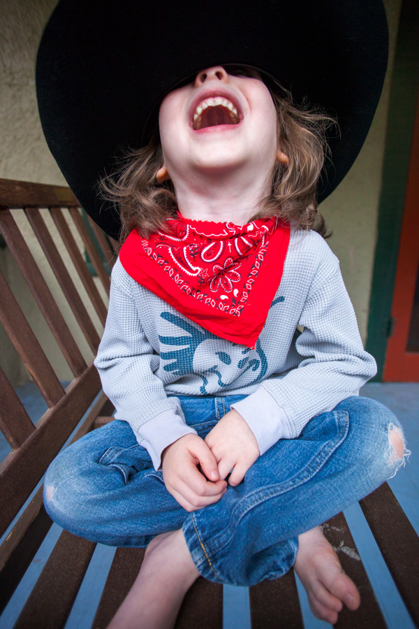 photo of a young boy dressed as a cowboy laughing, Willa Stein Photography