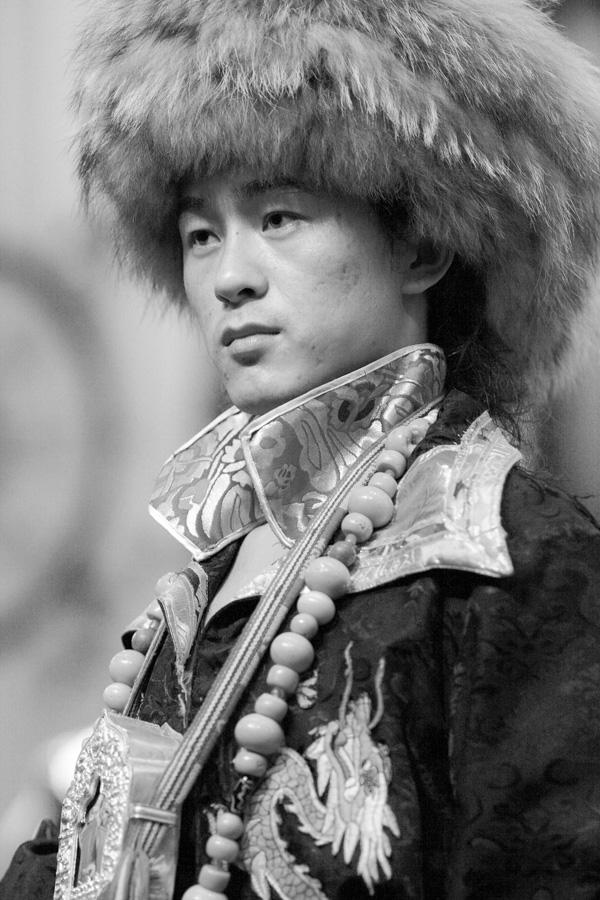 Asian Tibetan man in a black and white photo Willa Stein Photography