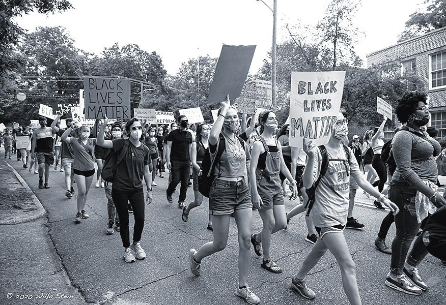 BLM march down Boylan Avenue, Raleigh, NC. Photo by Willa Stein