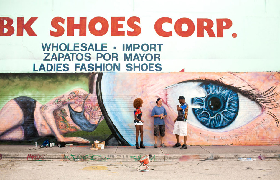 Graffiti artist against a painted wall in Wynwood artist district Florida