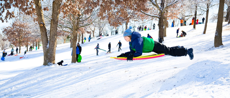 kid on sled at Dix Park Raleigh photo by Willa Stein