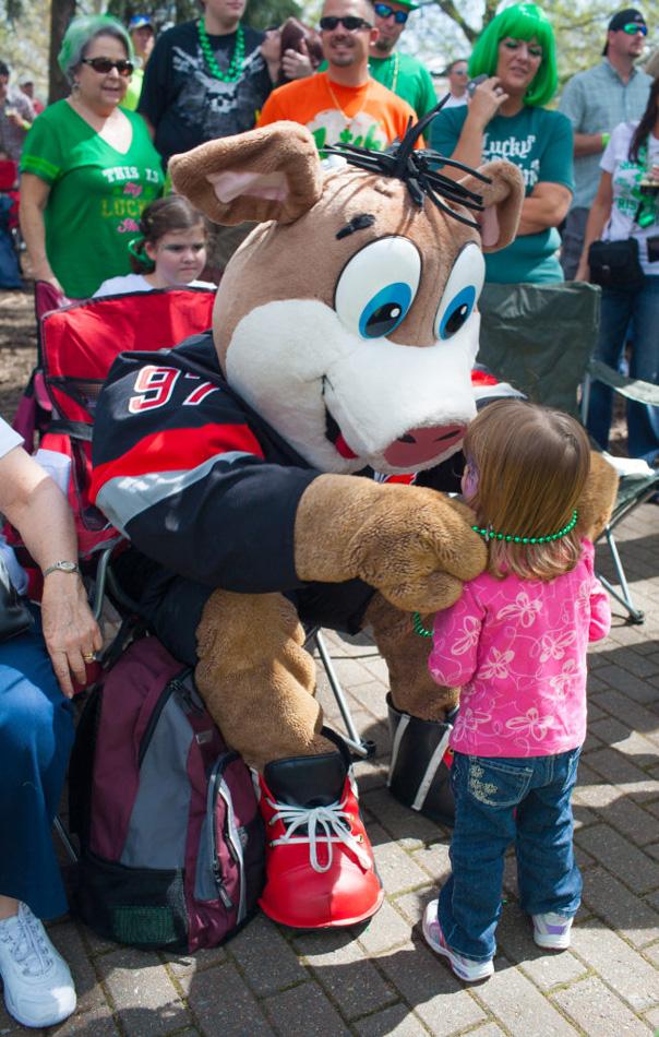 NC Hurricanes Mascot at parade with toddler