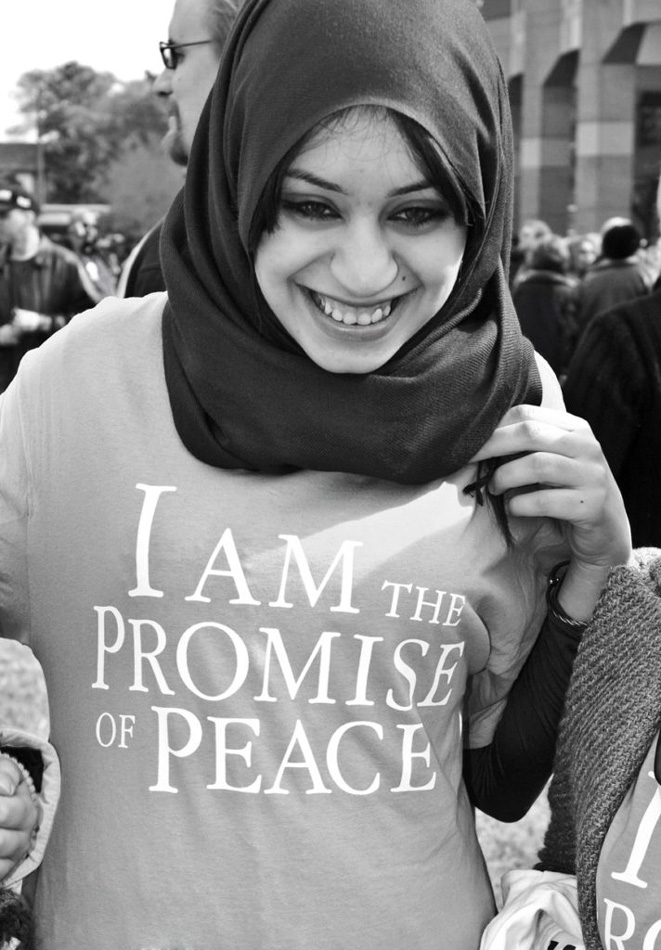 """Woman in burka wearing a t-shirt that says, """"I am the Promise of Peace"""" Photo by Willa Stein"""