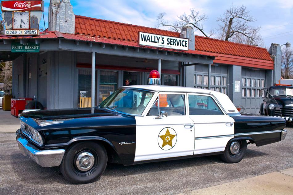by Willa Stein Vintage Police Car at garage in Mt. Airy NC