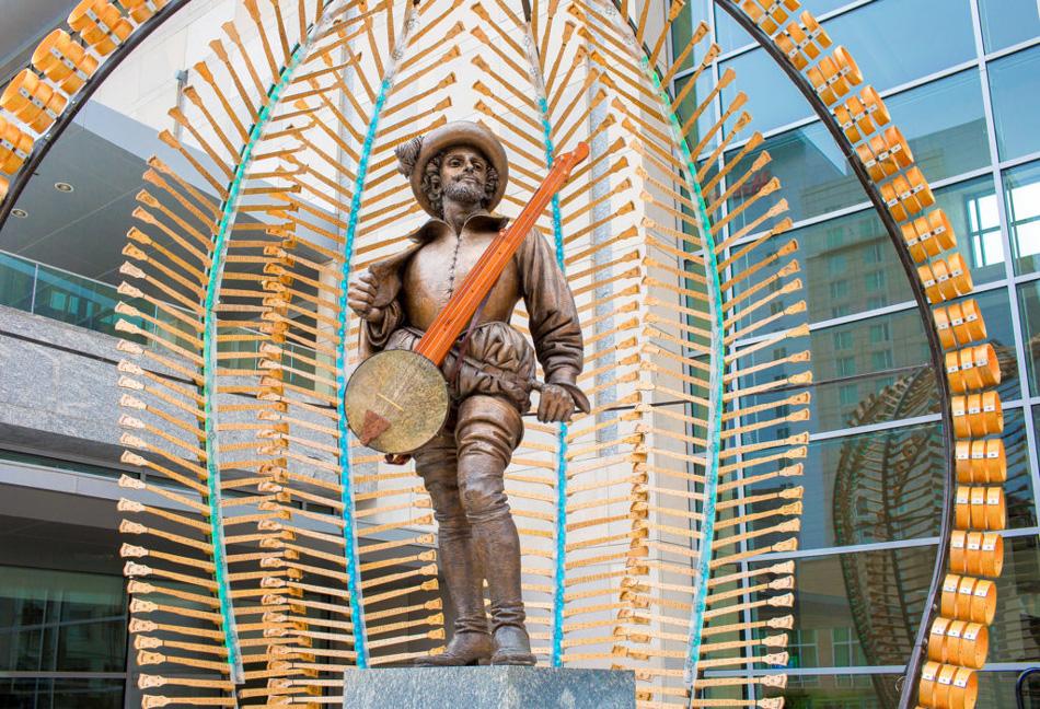 World of Bluegrass Sculpter, Sir Walter surrounded by Banjo necks, Willa Stein Photo